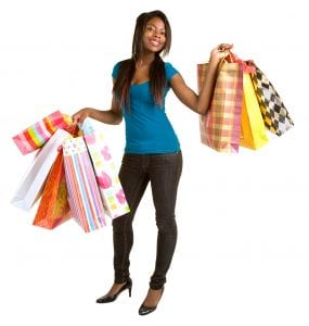 Lady holding shopping bags with discount diva styles dresses